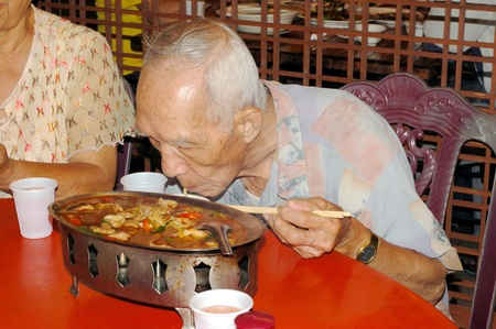 The Old people who Eat Chinese food In the restaurant