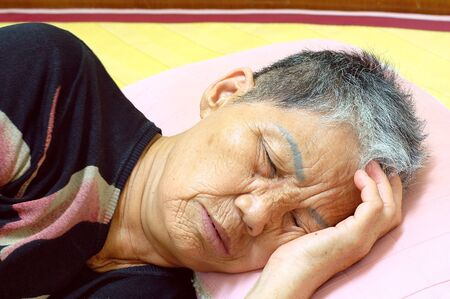 A Sleeping Old woman on bed