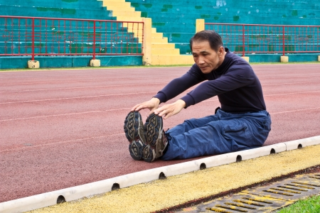 The Man who making Warm-up exercises before running on runway