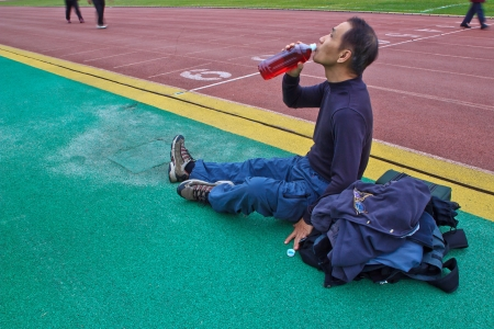 The Man who drinking plenty of waters After exercise Stock Photo