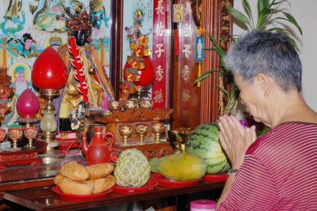 national fruit of china: A Chinese Woman who Pray with Sincere