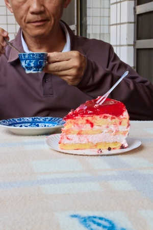 A Man who eating dessert with Coffee and Cake