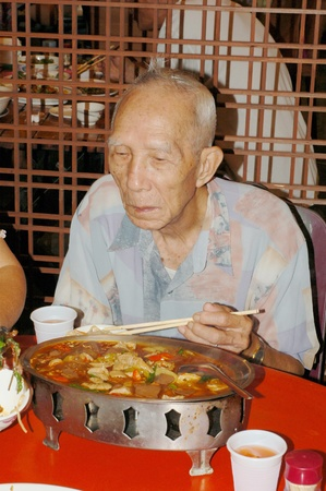 The elderly to enjoy Sichuan Cuisine of Chinese food in restaurant