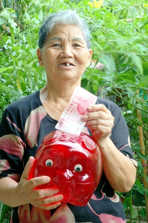 nt: An old Woman with the Pig Money bucket in Courtyard