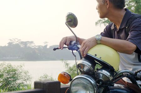 A man who Riding a motorcycle for trip