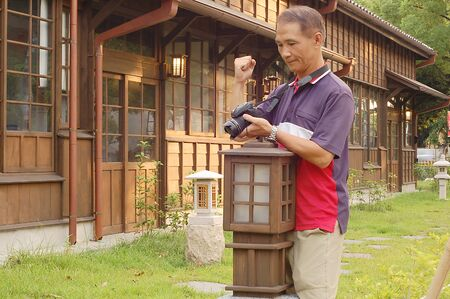 The Satisfied photographer who Watching Camera picture