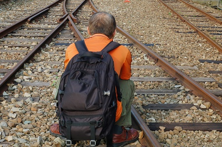 where to go: A Man who Decideing Where to Go beside the Railway