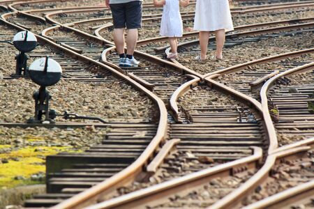 farther: The little girl with mother and farther on the Railway Stock Photo