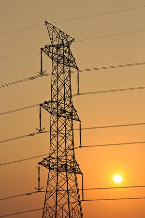 the setting sun: A High voltage electric tower with setting sun Stock Photo