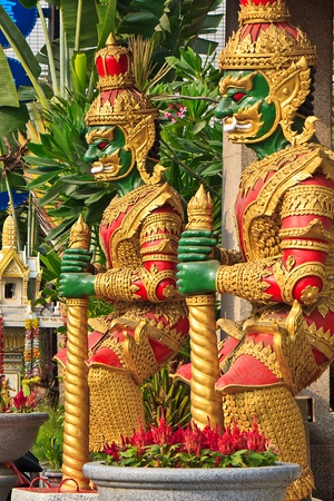 Two Colorful Thai statues front the Temple Stock Photo - 16142712