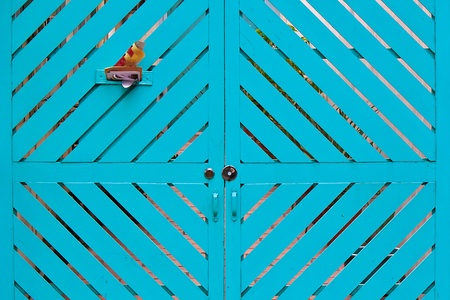 graphical: Blue graphical wooden door with letter box Stock Photo