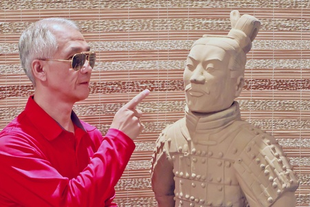 A Soldier Statue of Chinese Terracotta Army replica and tourist Stock Photo