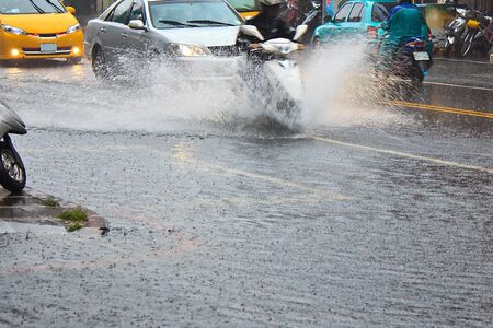 wading: A Wading motorcycle in Accumulation of water on the road Stock Photo