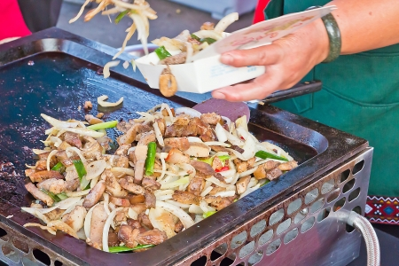 Cooking of pork cuisine for sale Stock Photo