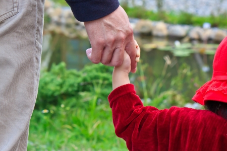 enhancing: Father holding the child for enhancing parent-child relationship