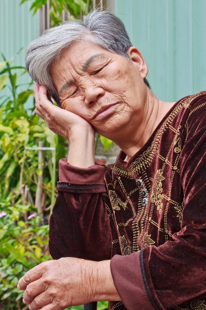 doze: A White hair Doze Chinese old woman on Chair Outdoor