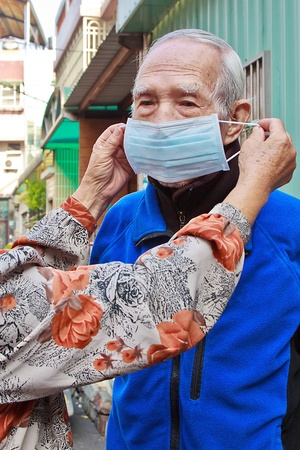 Help elderly people to wear a mask for Disease prevention