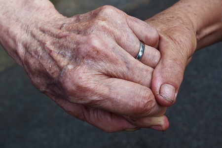 kinship: Holding hands of Old couple with a Ring Stock Photo