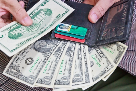 A variety of U S  dollars paper money and credit cards in Wallet Stock Photo