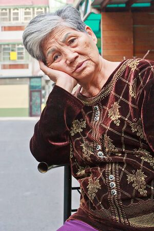 contemplative: A White hair Contemplative Chinese old woman Outdoor