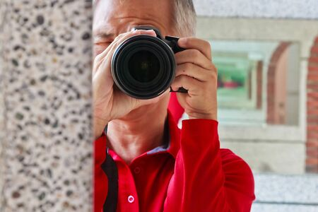 A photographer who taking a picture for Creation Stock Photo