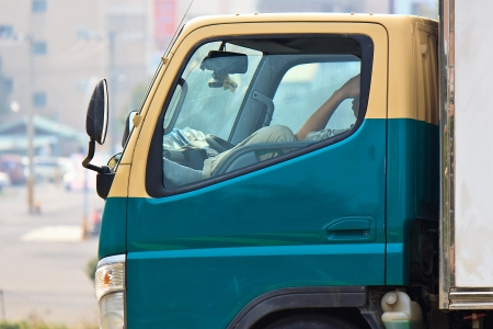 A Fatigue Lorry driver who resting in car Alone