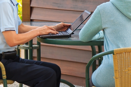 Man and woman who using laptop for Communication Outdoor Stock Photo - 18133230