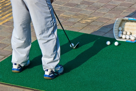 driving range: A man who playing golf for Leisure and Health at Driving range