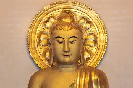 A Traditional Solemn Golden Buddha statue in Temple Stock Photo - 18756175