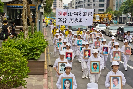 persecution: 2013 7 20 Taipei, Taiwan, Falun Gong practitioners held a large march against the persecution of Chinese Communist with candlelight vigil for Persecuted to death practitioners Editorial