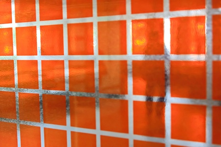 The Orange glass windows with Shadow of man
