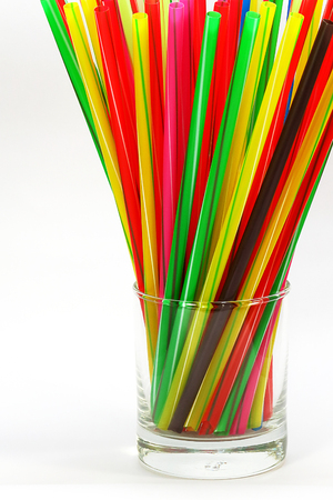 A Close-up of Colorful straws in Glass
