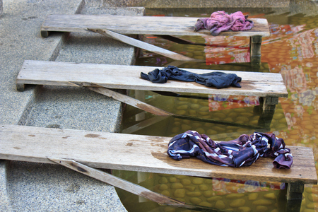 Traditional Washing clothes by hand with Wash plate waterside