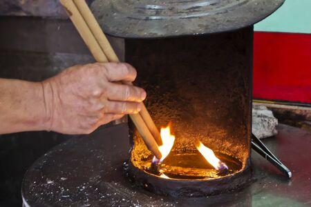 ignite: Ignite thus In oil lamp for Pray Stock Photo