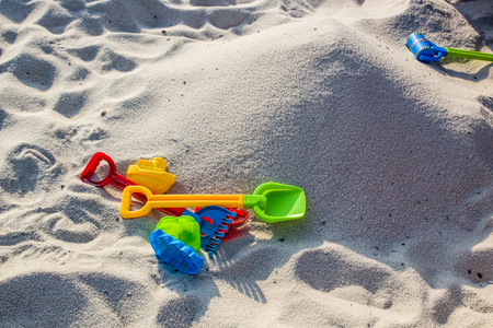 Sandpile and Plastic toys for playing on Sandy beach