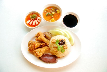 Rice steamed with chicken soup and Fried Chicken wings Stock Photo