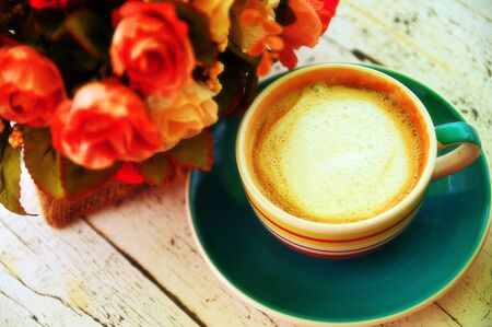 lightsome: Color full of Cappuccino with rose on a rustic table Stock Photo