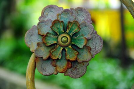 circumstantial: Curved steel flower with rust