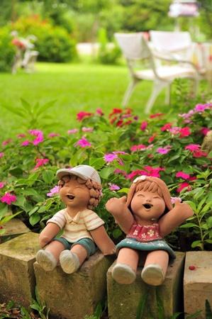 progeny: Happy girl and boy doll in garden