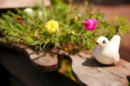 little white bird ceramic with Common Purslane