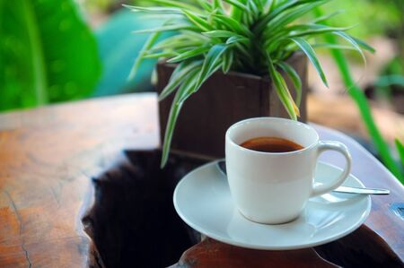 relent: Espresso on a folk art table Stock Photo