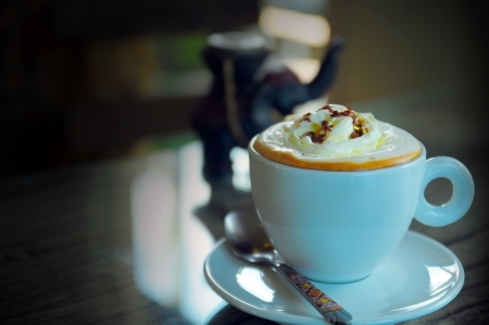 Coffee with Whipped cream in a white cup   Stock Photo