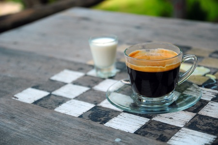 Espresso coffee with game on checkerboard  Stock Photo - 16678254