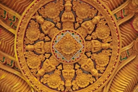 Golden Dharmachakra ; Wheel of Dhamma of Tawa Ravadee Stock Photo