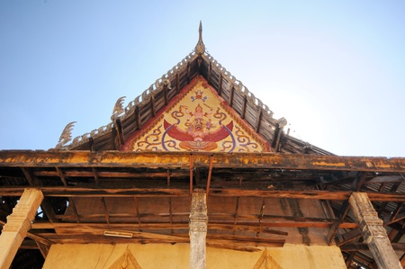 endangering: Gable of dilapidated temple in Thailand temple