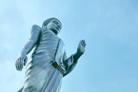 ism: big Buddha standing