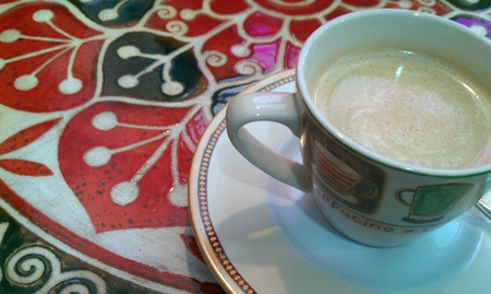 a cup of coffee on ornament table