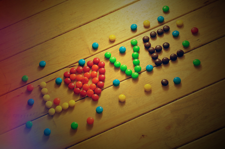 Lomo love word with colorful chocolate candies