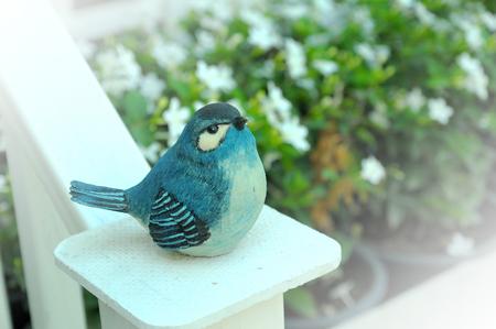 enrich: blue bird in garden background
