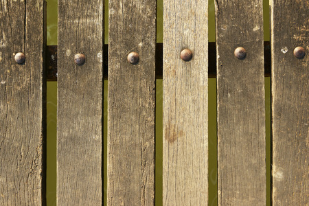 Slat floor and nail heads pattern background photo